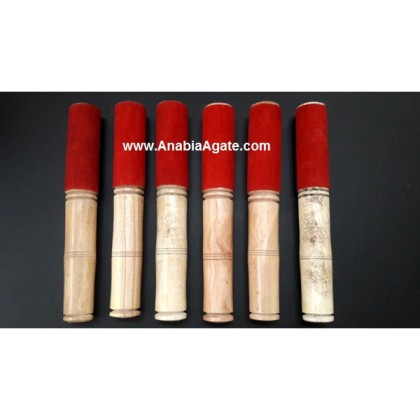 WOODEN STICKS WITH LEATHER